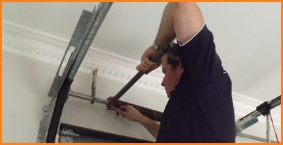 Garage Door Spring Repair And Replacement